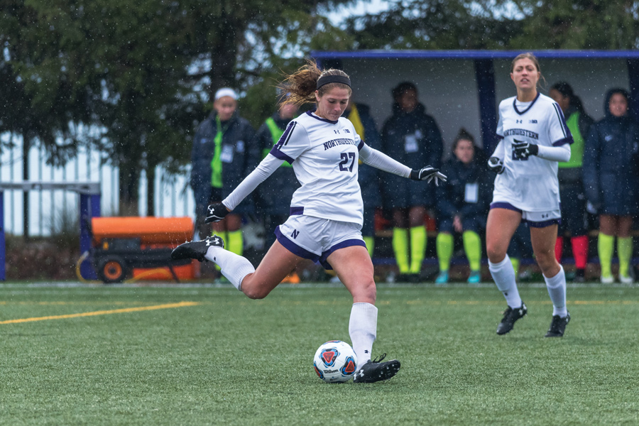Kayla Sharples plays a pass. The senior defender scored the game-winning goal on Friday.