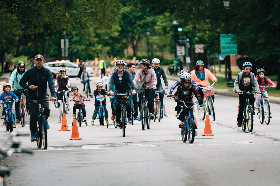 Noah Frick-Alofs / Daily Senior Staffer A group of cyclists ride down Ridge Avenue during the 2018 Bike the Ridge event. The city closed Ridge Avenue to vehicular traffic to create a safe environment for family cycling, with entertainment events such as live music and food trucks.