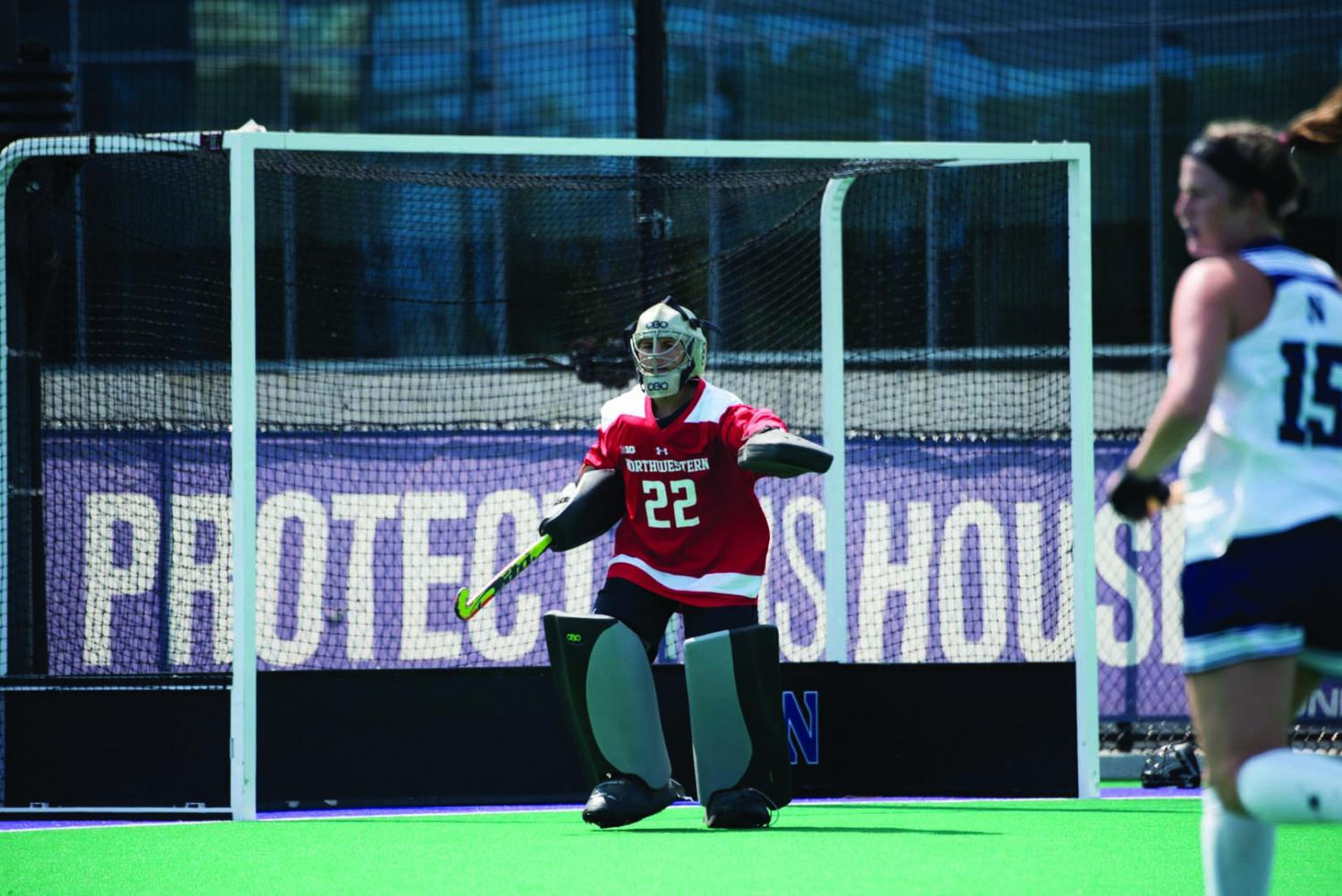 Annie Kalfas directs her defenders. The junior goaltender said the Wildcats will have last year's losses to Michigan on their minds when they play the Wolverines on Friday.
