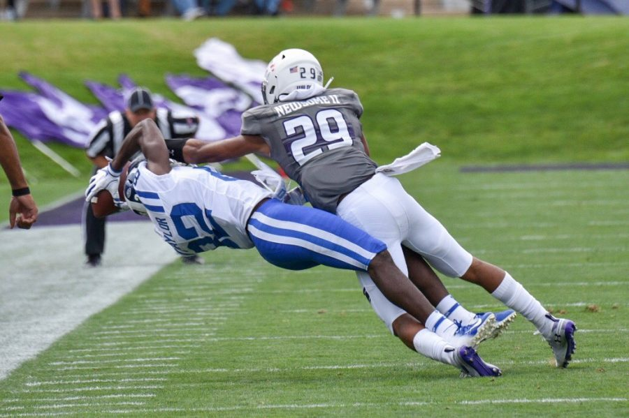 Northwestern cornerback Greg Newsome and Duke receiver Chris Taylor reach for the football. Duke and Northwestern played a defensive game Saturday at Ryan Field
