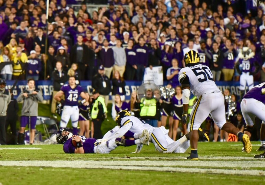 Northwestern+quarterback+Clayton+Thorson+hits+the+ground.+Michigan+sacked+Thorson+six+times+and+stifled+Northwestern%27s+offense+in+a+20-17+comeback+victory.