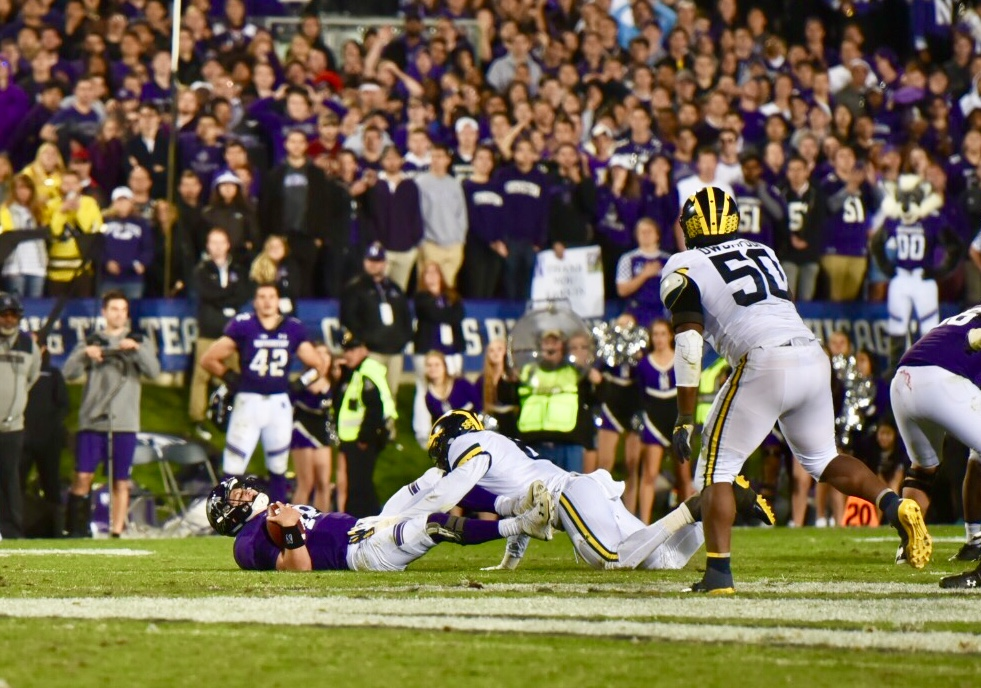 Northwestern quarterback Clayton Thorson hits the ground. Michigan sacked Thorson six times and stifled Northwestern's offense in a 20-17 comeback victory.