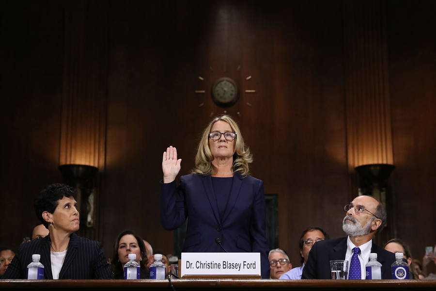Christine Blasey Ford, center, is sworn in before testifying to the Senate Judiciary Committee on Sept. 27. Ford is one of three women to accuse Supreme Court nominee Brett Kavanaugh of sexual misconduct.