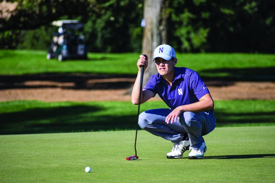 (Alison Albelda/Daily Senior Staffer) Everton Hawkins lines up a putt. The junior finished the Windon Memorial Classic at 4-over-par.