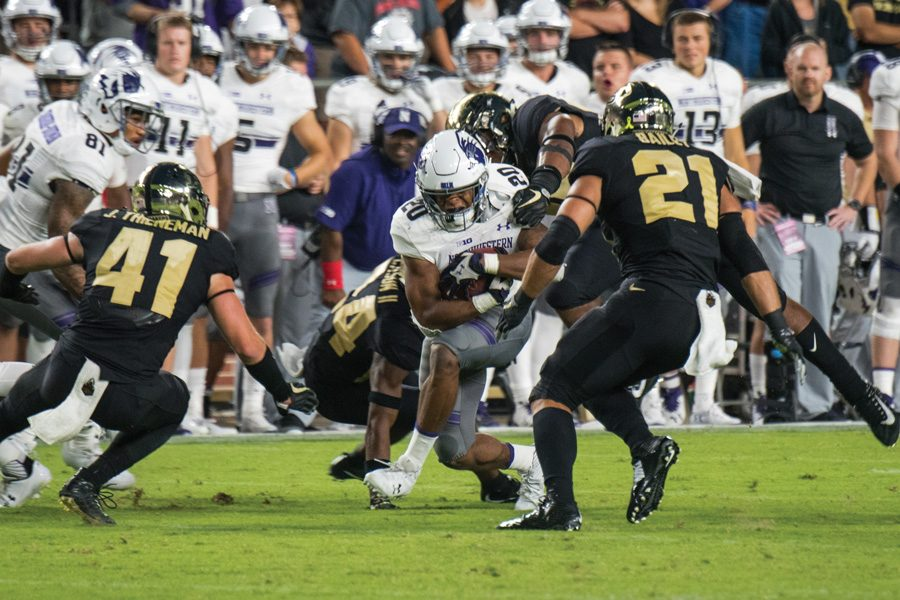 John Moten meets defenders. The junior is set to become NU's lead rushing option.