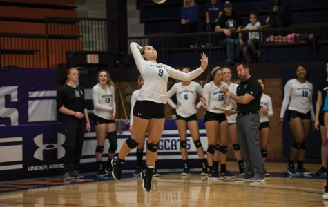 (Daily file photo by Katie Pach) Sarah Johnson attempts a serve. The junior libero had 14 digs against Purdue.