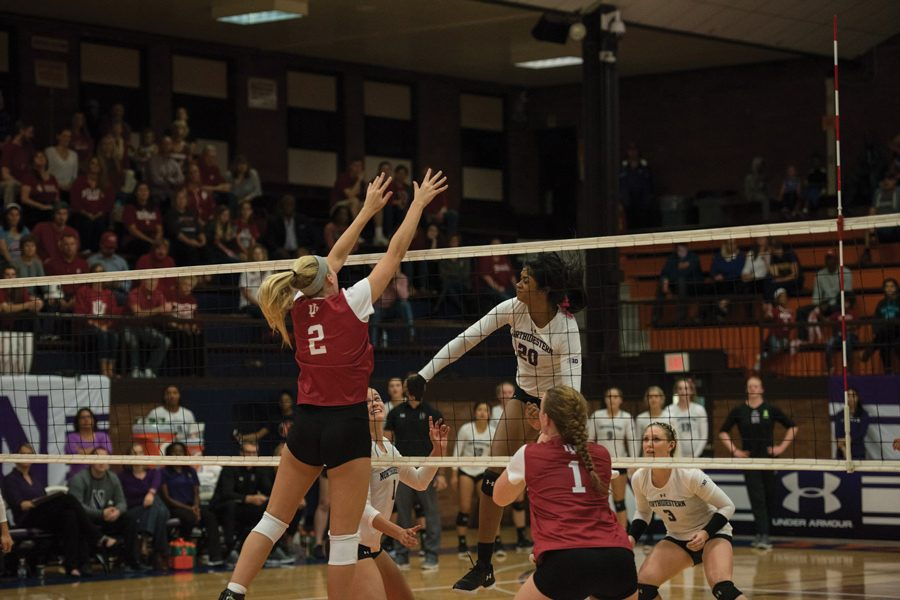 Alana Walker strikes a ball. The sophomore middle hitter leads the team with 49 blocks on the season.