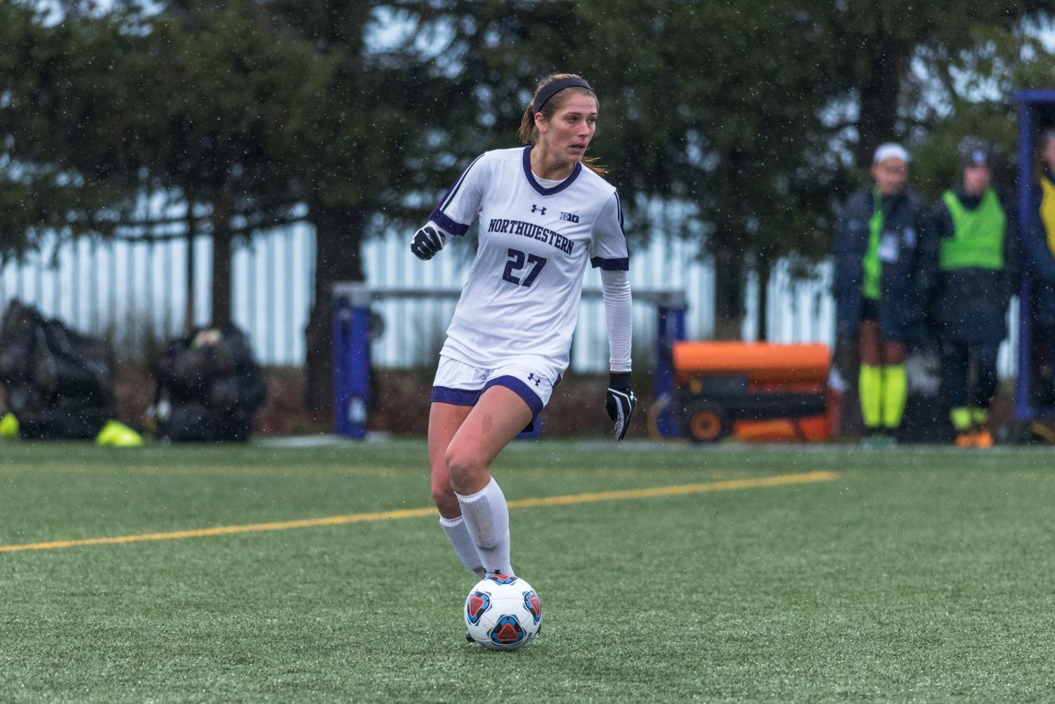 (Daily file photo by David Lee) Kayla Sharples surveys the pitch. The senior defender has helped the Northwestern defense allow only five goals all season.