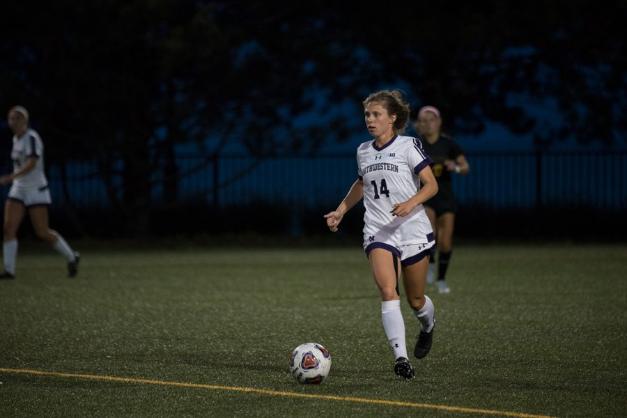 Marisa+Viggiano+dribbles+upfield.+The+senior+midfielder+provided+the+assist+for+Friday%E2%80%99s+lone+goal.