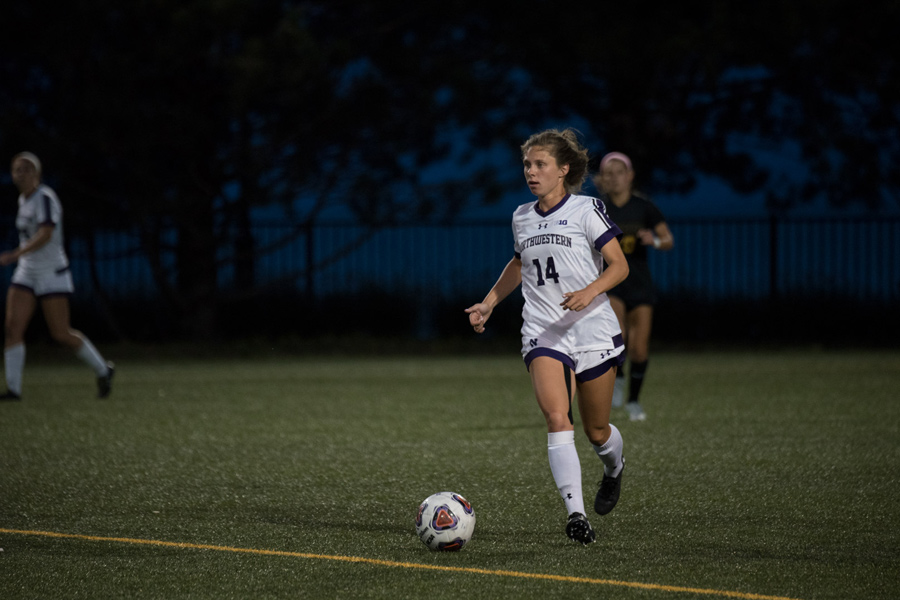 Marisa Viggiano dribbles upfield. The senior midfielder provided the assist for Friday's lone goal.