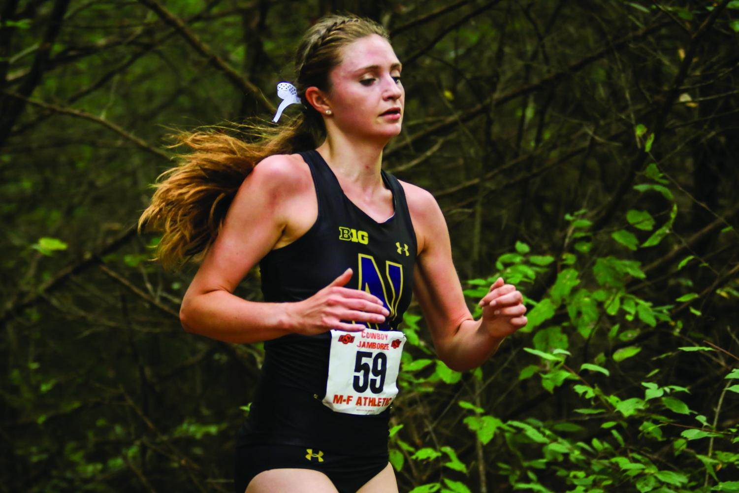 Sarah Nicholson runs. The junior finished in fifth at the Badger Classic.