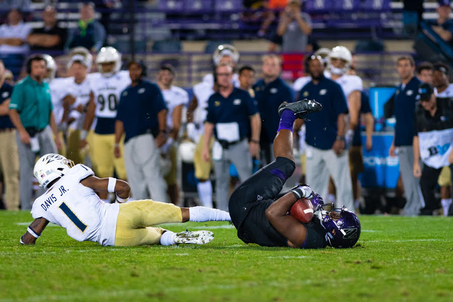 A Northwestern player lies on the ground. The Wildcats were overrun in the second half by Akron en route to a 39-34 defeat on Saturday.