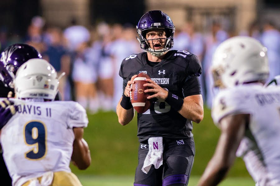 Clayton Thorson surveys the field. The senior quarterback's three critical turnovers were decisive in Northwestern's loss to Akron.