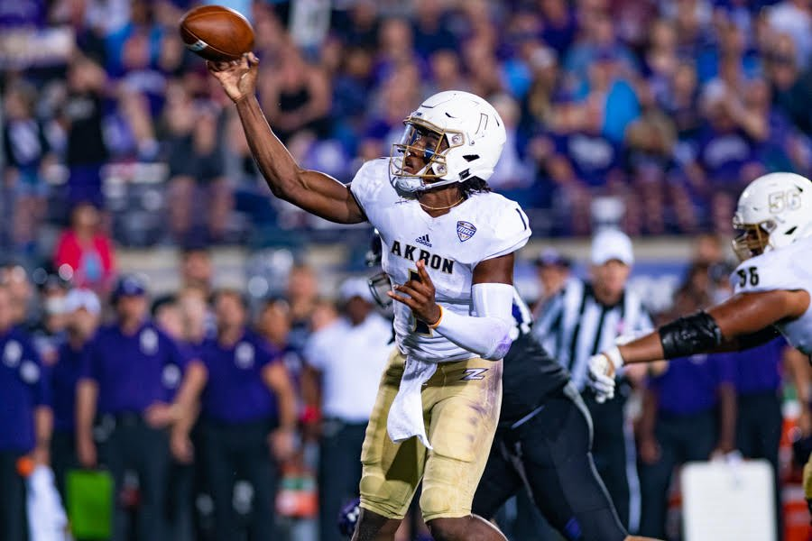 Kato Nelson fires a ball downfield. The Akron quarterback led the Zips to a stunning upset of Northwestern on Saturday.