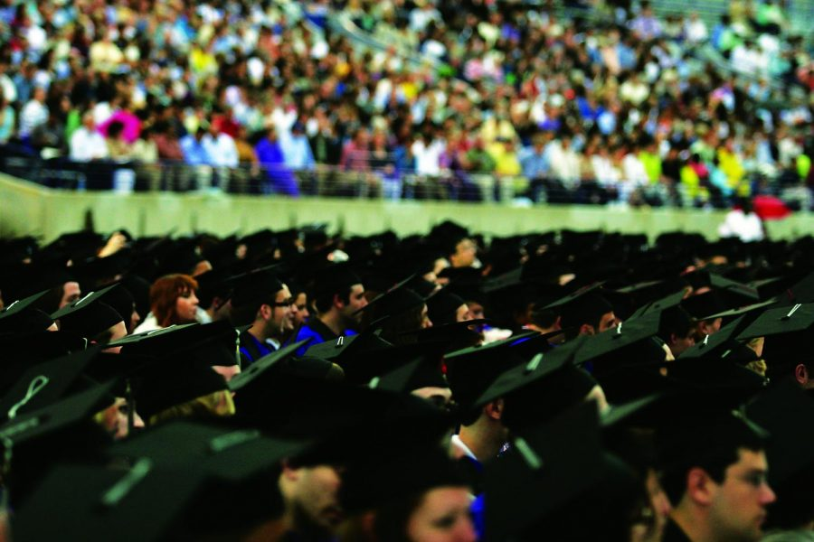 Graduating+students+look+forward+to+the+future+during+the+University%E2%80%99s+2009+Commencement.+Ten+years+later%2C+some+are+still+scarred+by+the+Great+Recession.+%0A