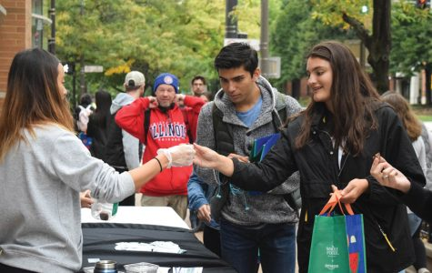 Students check in for Big Bite Night outside of Whole Foods. Sunday's event, hosted in conjunction with Associated Student Government, showcased 33 Evanston restaurants.