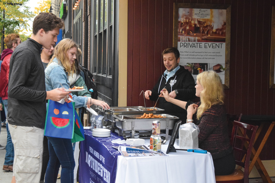 Students collect free samples at Big Bite Night. The annual event featured 33 restaurants that handed out samples and promotional materials to students and other attendees.