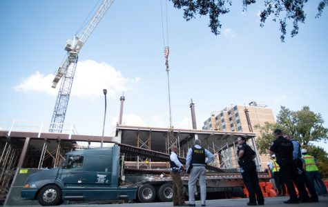 Evanston Police Department officers at the 800 block of Emerson street. A crane set up on the site dropped a steel beam on two construction workers on Thursday.