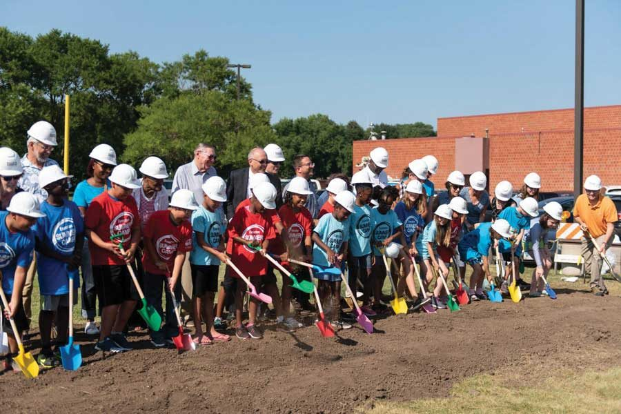 City officials and kids from Evanston Summer Camps shovel dirt at the Robert Crown Community Center groundbreaking ceremony. The complete renovation of the center is scheduled to finish in fall 2019.