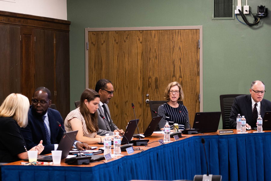 Evanston Township High School/District 202 board members listen to reports during a Monday meeting. The figures presented showed that racial disparities still exists in summer school attendance, student activities and disciplinary action — although the latter has improved drastically.