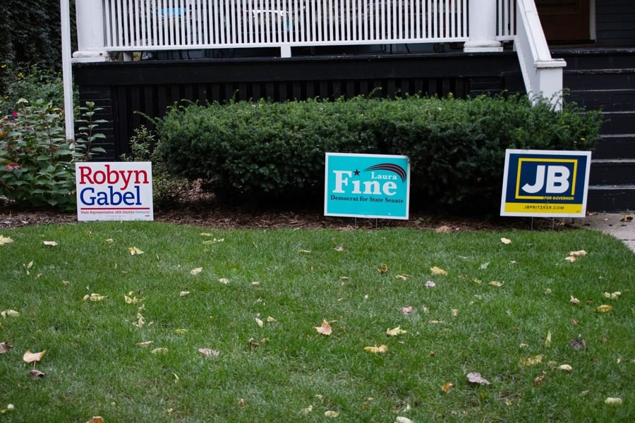 Lawn+signs+on+Orrington+Avenue.+The+Democratic+Party+of+Evanston+projected+higher+turnout+and+civic+engagement+on+Nov.+6+compared+to+the+2014+midterm+election.+