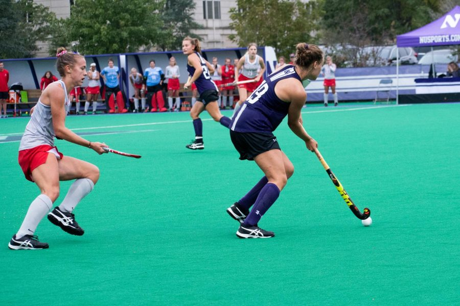 Puck+Pentenga+looks+to+play+a+pass.+The+senior+midfielder+provided+an+assist+against+Michigan.