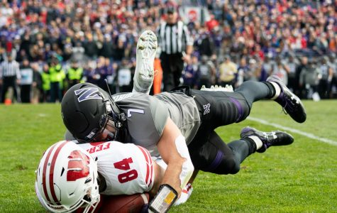 Football: Defense tames Taylor, Wisconsin rushing attack in upset win
