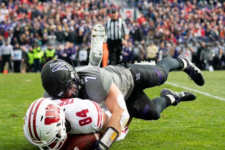 Sophomore+defensive+back+Travis+Whillock+tackles+Wisconsin+tight+end+Jake+Ferguson+during+Northwestern%27s+31-17+win+Saturday.+Whillock+and+the+defense+contained+the+Badgers+all+game+long.