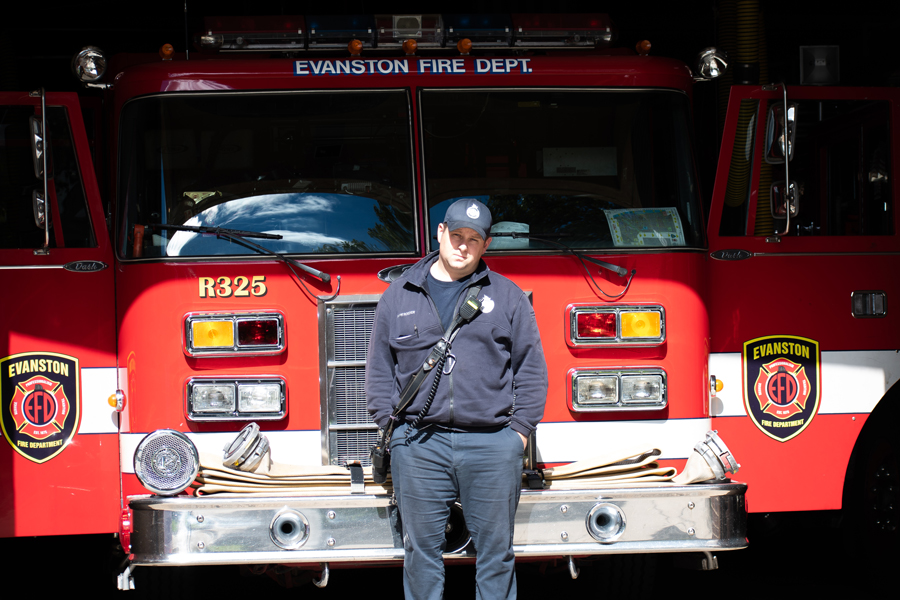 A firefighter/paramedic stands in front of Station 4's fire engine. City manager Wally Bobkiewicz said if the proposed budget is approved, Station 4 will be shut down and the building will be sold.
