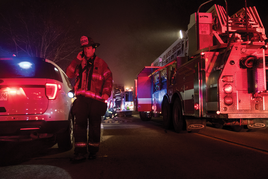 Evanston Fire Chief Brian Scott responds to the scene of a fire that broke out in a garage in the 600 block of Ridge Avenue on February 28, 2018. Scott said closing Station 4 would cause an increase in response times across the city.