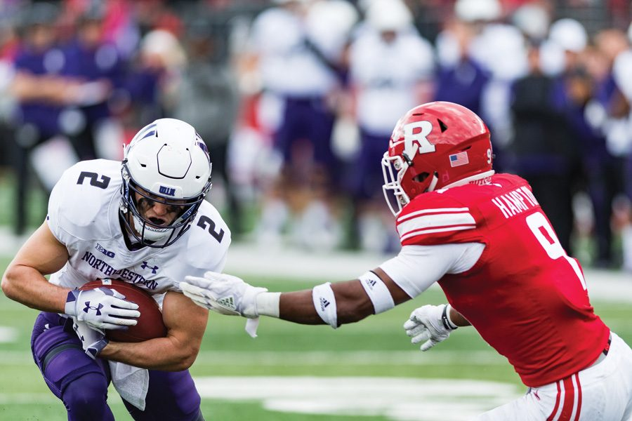 Flynn Nagel eyes the yard line needed for a first down in Northwestern's crucial fourth-down conversion last Saturday against Rutgers. The Wildcats are 8-for-18 on fourth downs so far this season.