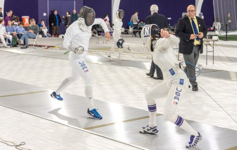 A Northwestern fencer lands a touch. The Wildcats hosted the 2018 Remenyik Open in Ryan Fieldhouse.