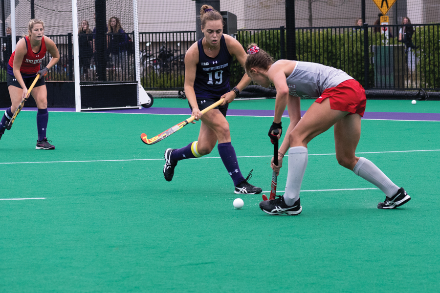 Puck Pentenga fights for the ball. The senior midfielder is the team leader in points.