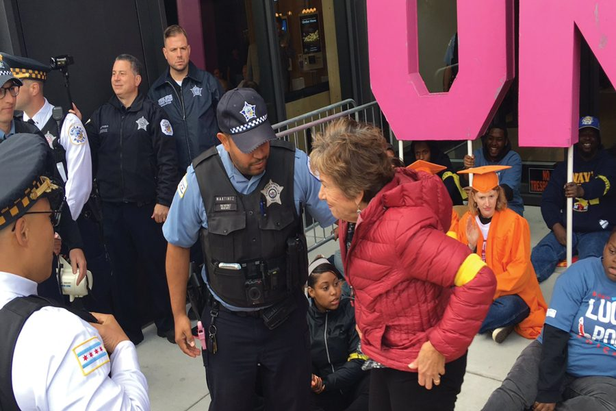 A+police+officer+arrests+U.S.+Rep.+Jan+Schakowsky+%28D-Ill.%29.+The+representative+was+protesting+as+part+of+the+%E2%80%98Fight+for+%2415%E2%80%99+campaign.