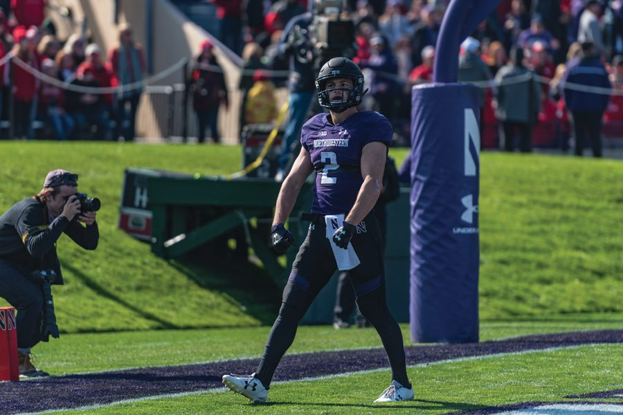 Flynn+Nagel+celebrates+a+touchdown.+The+senior+was+one+of+two+NU+players+who+earned+Big+Ten+recognition+after+Saturday%E2%80%99s+win+over+Nebraska.%0A%0A%0A