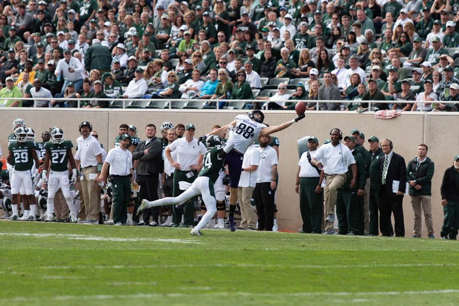 Junior receiver Ben Skowronek stretches for a pass. The passing game clicked for Northwestern all afternoon long in a 29-19 upset win over Michigan State.