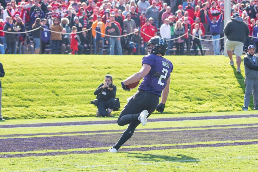 Flynn+Nagel+sprints+into+the+end+zone.+The+senior+receiver+had+220+receiving+yards+in+Northwestern%27s+stirring+victory+over+Nebraska.