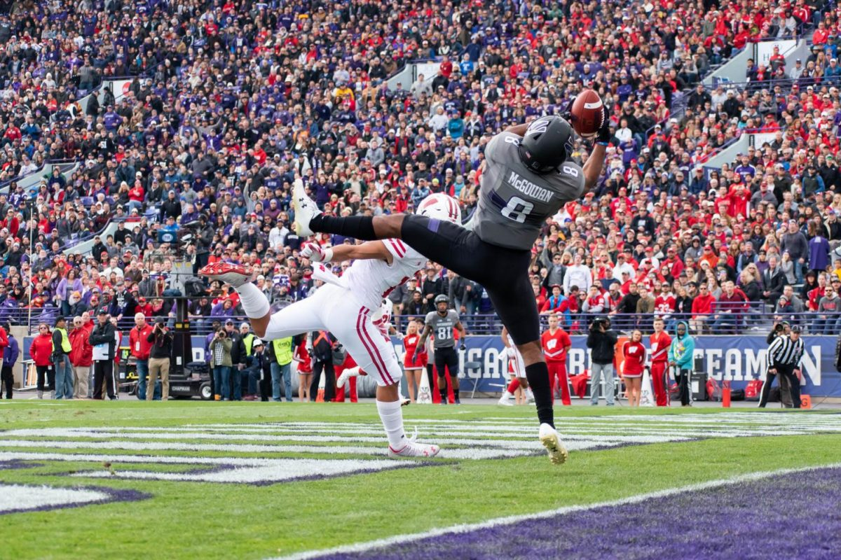 Sophomore receiver Kyric McGowan stretches for a touchdown reception during the third quarter of Saturday's game. McGowan's big play helped Northwestern pull away for a 31-17 win over Wisconsin.