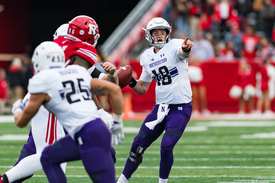 Quarterback Clayton Thorson signals to a receiver during Northwestern's game at Rutgers on Saturday. Thorson and the offense struggled, but a late score lifted the Wildcats to an 18-15 win.