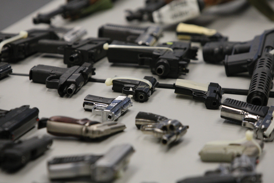 Confiscated guns on display at police headquarters in Chicago. Despite a 28 percent reduction in shootings since last year, Chicago is still one of America's deadliest cities.