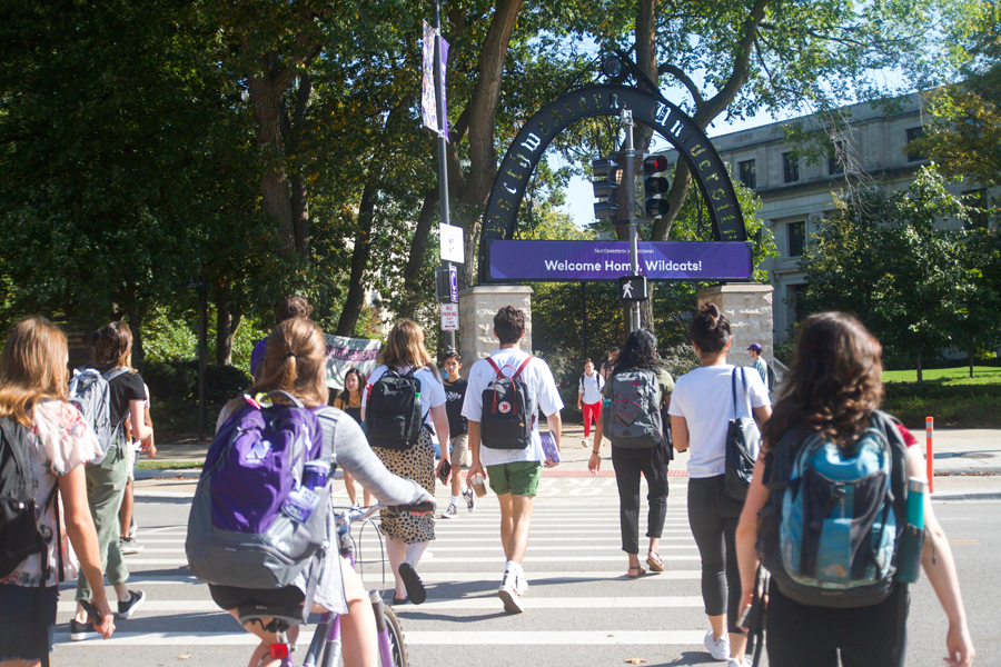 (Allison Ma/The Daily Northwestern) Students walk across Sheridan Road. A 2016 survey conducted by the UCLA Higher Research Education Institute reported that more than 70 percent of college freshman experience some degree of homesickness.