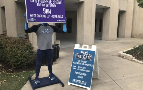 A mannequin holds up a sign for BTN Tailgate. The television program will be broadcasting from a parking lot next to Ryan Field on Saturday.