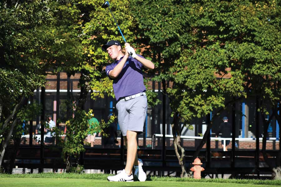 Eric McIntosh drives a golf ball. The sophomore finished in the top-10 at the Marquette Invitational.