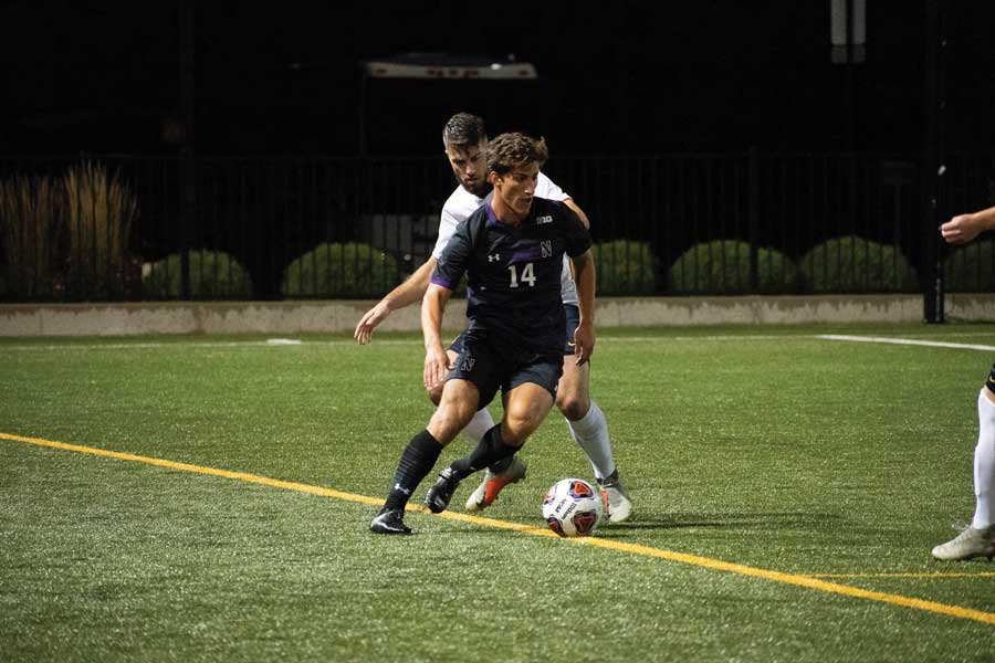 Julian Zighelboim defends a player. The freshman defender has started all 14 games for the Cats this season.