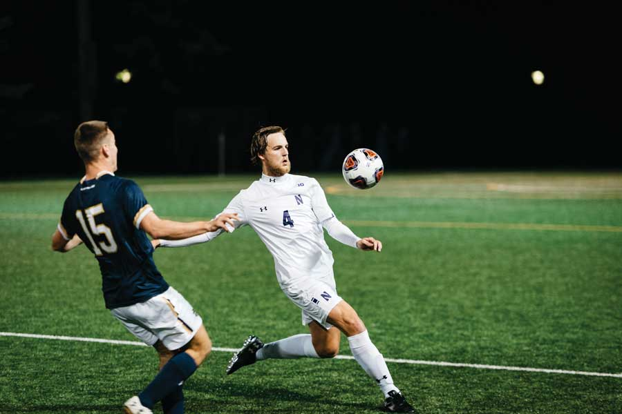 Garrett Opperman looks to send the ball upfield. The sophomore defender scored in the seventh minute of the game.