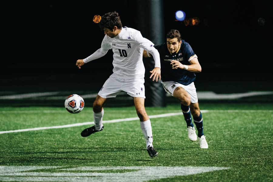 Tommy Katsiyiannis fends off a defender. The sophomore midfielder provided the assist for Northwestern's goal.