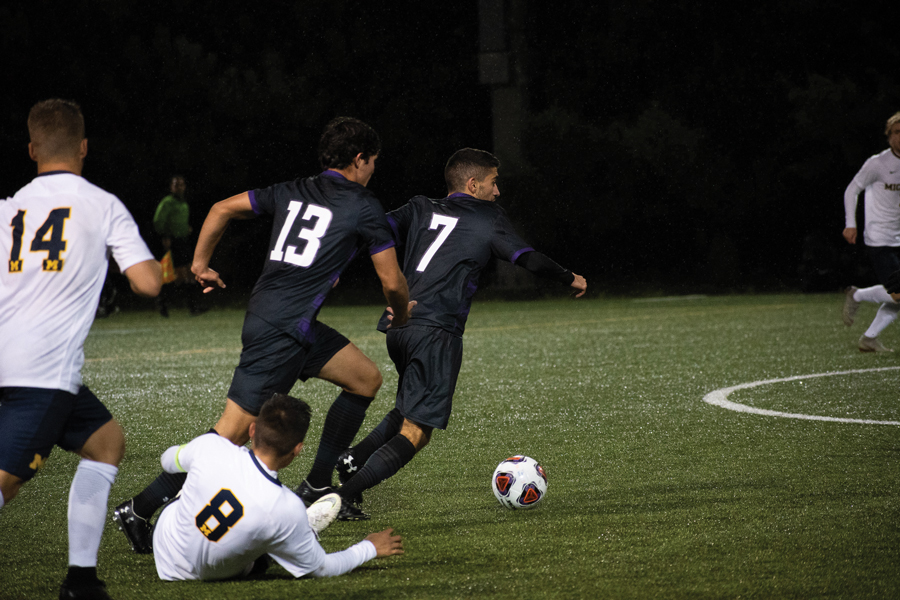 Bardia Kimiavi dribbles the ball. The freshman midfielder has played in all 16 games this season.
