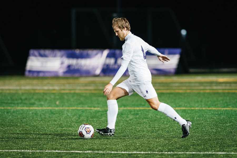 Garrett+Opperman+kicks+the+soccer+ball.+The+sophomore+defender+helped+hold+Penn+State+scoreless.%0A