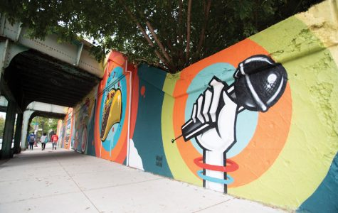 Anthony Lewellen's  finished mural on Church Street and Maple Street. The public work was completed in late September.