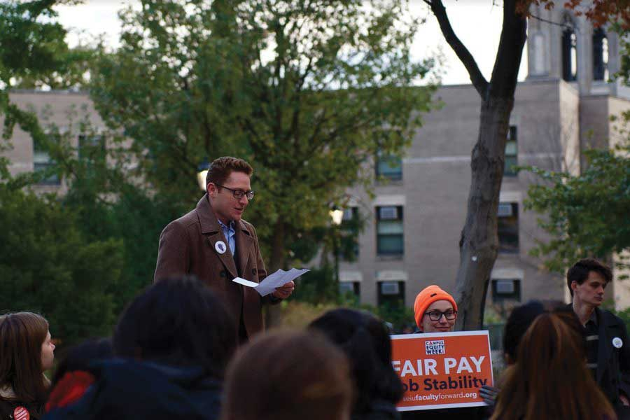 A doctoral student rallies for NTE faculty unionization in 2017. The bid to form a union eventually failed Tuesday when formerly contested ballots were counted, and only two of the 25 voted in favor.